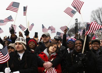 People cheer on the National Mall during the ceremonial swearing-in ceremonies on the West front of the U.S. Capitol in Washington January 21, 2013. REUTERS/Shannon Stapleton (UNITED STATES - Tags: POLITICS)